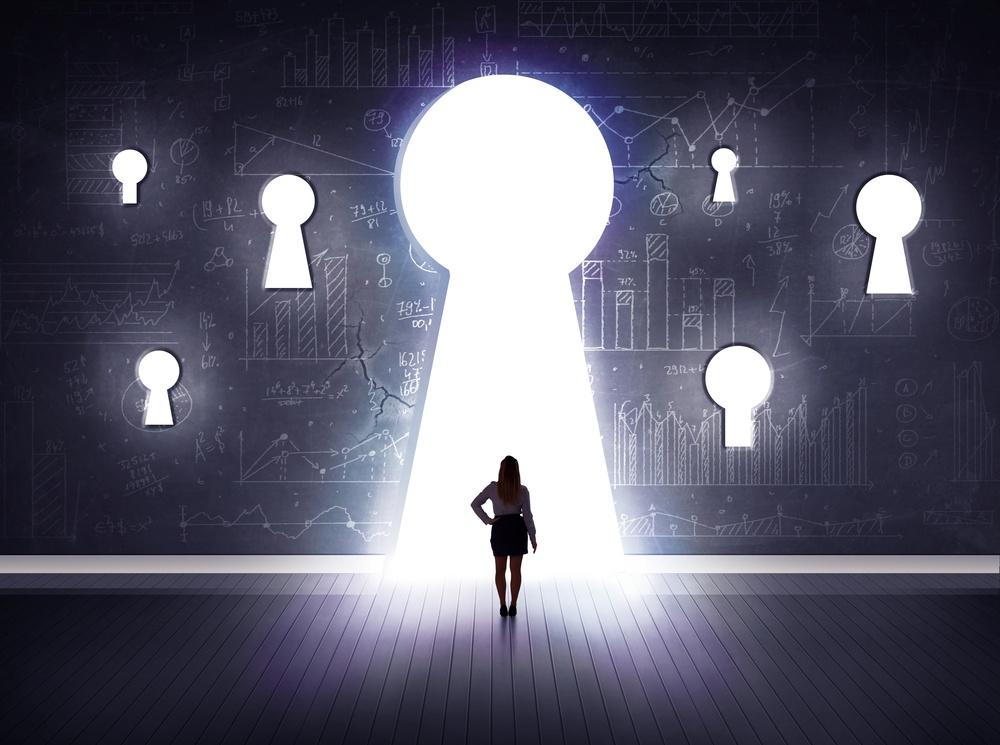Successful businessman looking through keyhole.jpeg